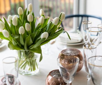 A closeup of flowers as a table centerpiece.